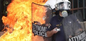 Riot police hit with molotov cocktail during nationwide strike over austerity measures in Athens
